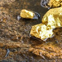 The pure gold ore found in the mine on a stone floor